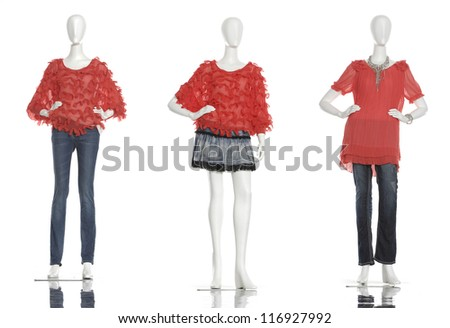 Row of female mannequins in red clothes with on white background - stock photo