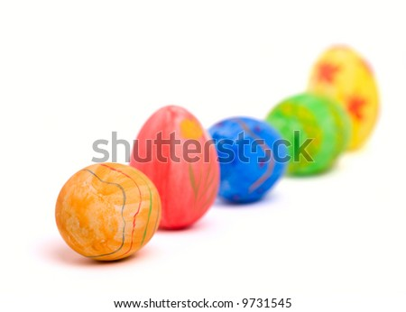 Row of five colorful Easter eggs isolated on white background