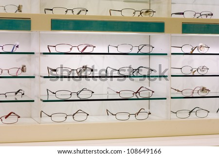 row of glasses at an opticians. - stock photo