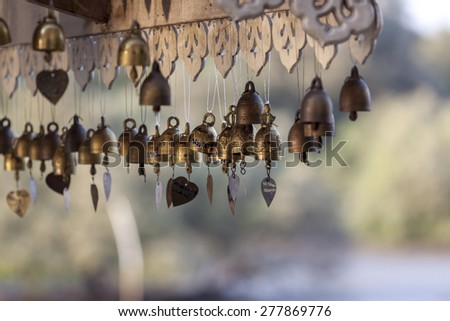 Row of golden bells in buddhist temple