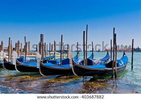 Row of gondolas in Venice, Italy - stock photo