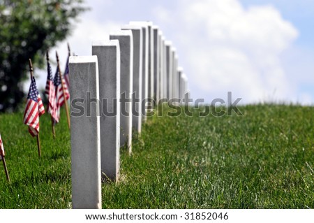 Row of graves with decorated with U.S. flags on Memorial Day at the Arlington National Cemetery in Virginia, near Washington DC - stock photo