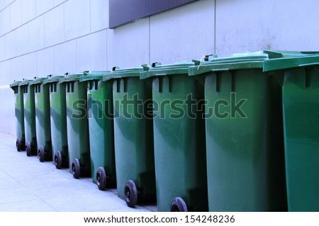 Row of green and clean rubbish bins on the street. - stock photo