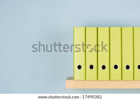 Row Of Green Ring Binders - stock photo