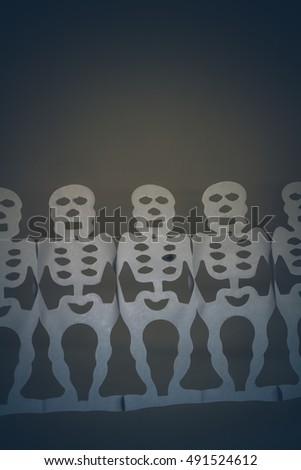 Row of hanging skeletons for Halloween