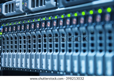 Row of harddisk slot on computer server with depth of field in cool tone - stock photo