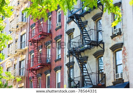 Row of historic New York City tenement apartments from the 19th century - stock photo