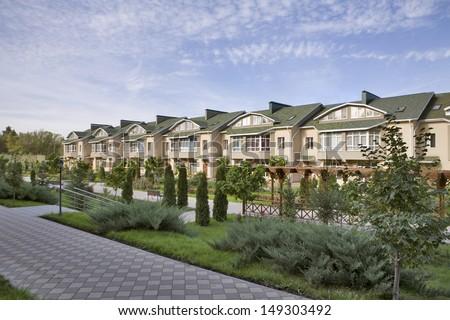 Row of houses in suburban neighborhood - stock photo