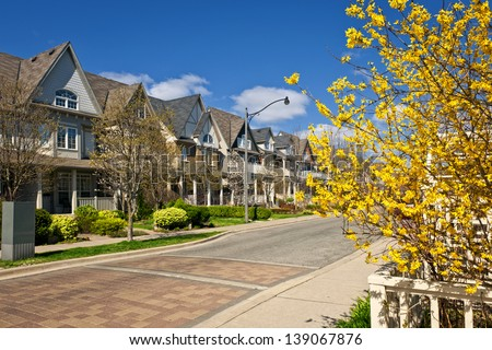 Row of houses on spring street in Toronto Canada - stock photo