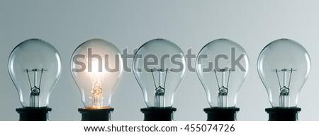 Row of light bulbs. Idea concept - stock photo