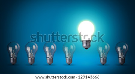 Row of light bulbs.Idea concept on blue background. - stock photo