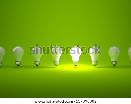 Row of light bulbs on green background