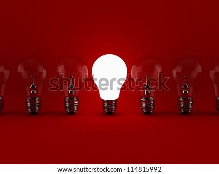 Row of light bulbs, with one different - stock photo
