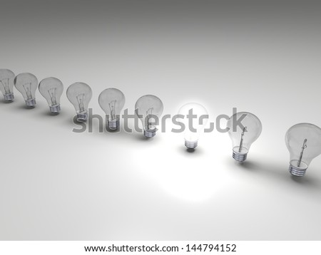 Row of lightbulbs, concept of one bright idea