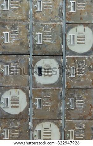 row of lockers with dramatic lighting - stock photo