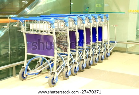 Row of luggage carts at international airport - stock photo