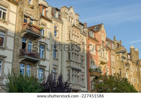 Row of majestic old buidings in autumn - stock photo