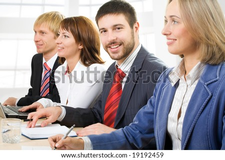Row of mature students at business conference - stock photo