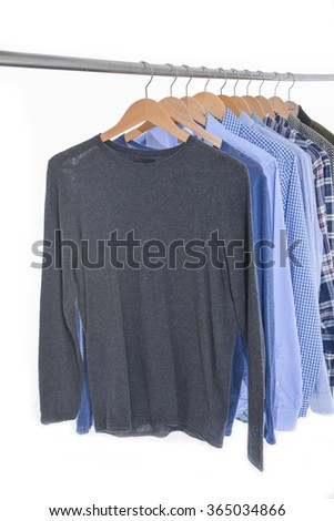 Row of men's clothing on a hanger  - stock photo
