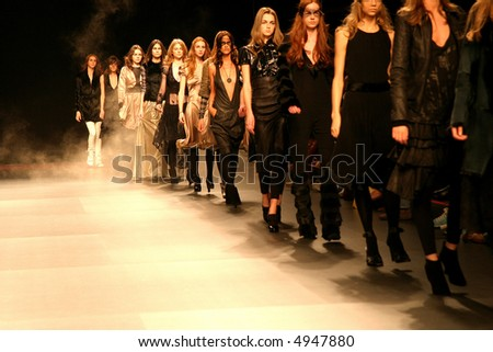 row of models in a runway - stock photo