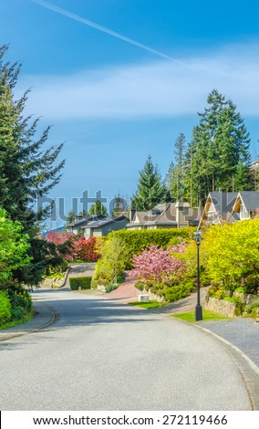Row of modern houses in great neighborhood, in suburbs of Vancouver, Canada. Vertical. - stock photo