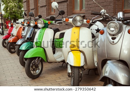 Row of mopeds on a street  - stock photo