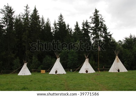 Row of native American sheleters - teepees - stock photo