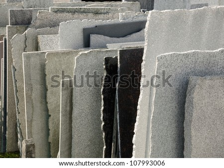 Row of natural stone panels in a mason's yard - stock photo