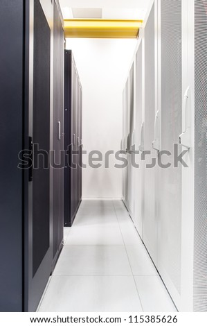 Row of network servers in data center room - stock photo