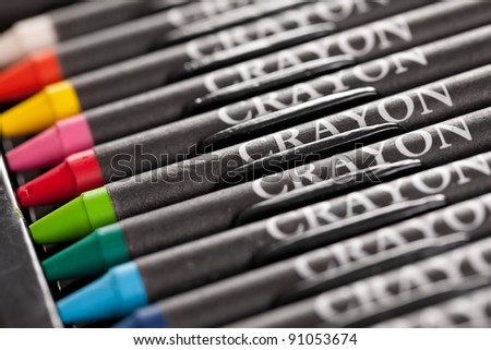 Row of new crayons in a box - stock photo