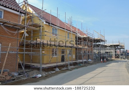 row of new houses under construction - stock photo