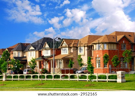 Row of new residential houses in suburban neighborhood - stock photo