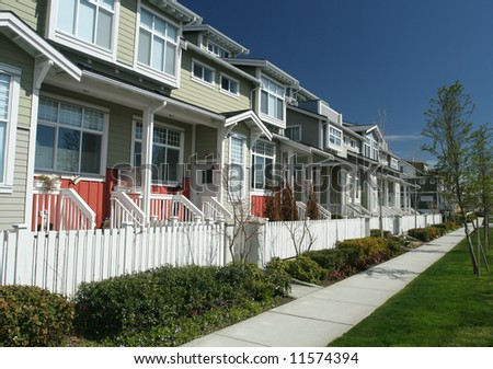 Row of New Townhouses With Porches - stock photo