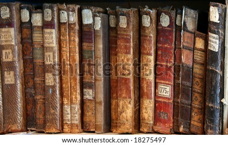 Row of old  books cover spines