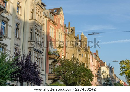 Row of old buidings in autumn - stock photo
