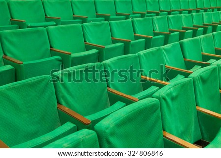 Row of old green seats in cinema - stock photo