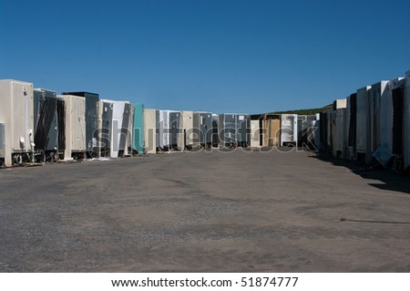 Row of old refrigerators for recycling - stock photo