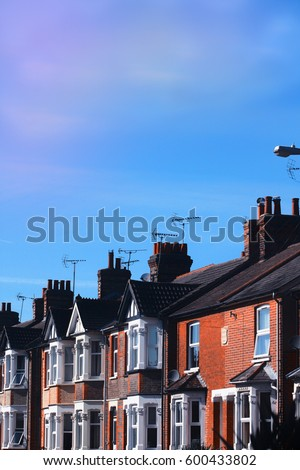 Row of orange British bricks terraced houses with a lovely colorful sky background, Spring time of England UK.