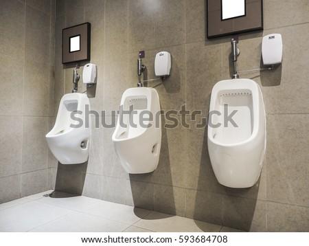 Row outdoor urinals men public toiletcloseup stock photo for Mens bathroom designs