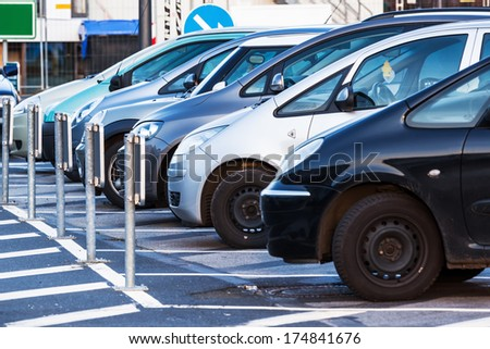row of parking cars - stock photo
