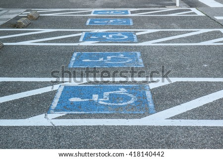 row of parking cripple, disabled parking sign - stock photo