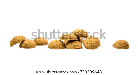 Row of Pepernoten cookies as Sinterklaas decoration on white background for dutch sinterklaasfeest holiday event on december 5th