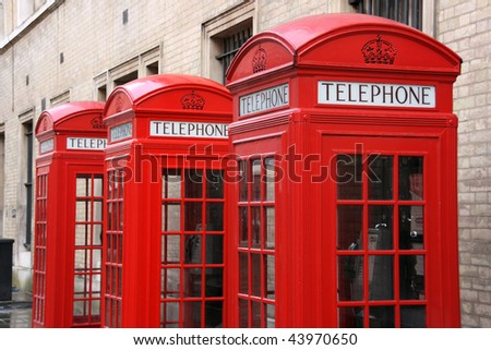 Row of phone booths in London, England. Street view. - stock photo