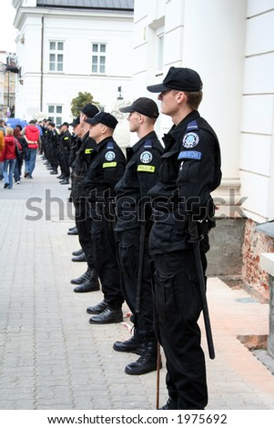 Row of police officers in front of the Presidential Palace in Warsaw on October 7th 2006 by supporters of Platforma Obywatelska (Citizen's Platform) party - stock photo