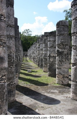 Row of posts at Chichen Itza in Mexico. - stock photo