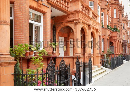 Row of red bricks houses in London, english architecture