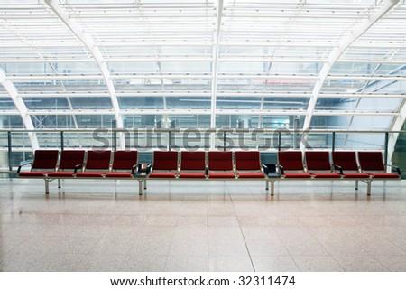 row of red chair at airport in Hongkong - stock photo