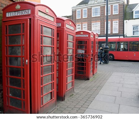 Row of red public telephone boxes in London