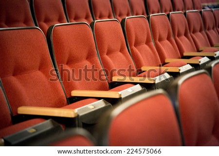 Row of red theatre seats - stock photo