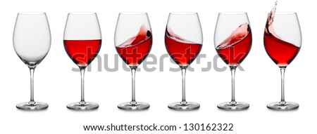 row of rose wine glasses, full, empty and with splashes. - stock photo